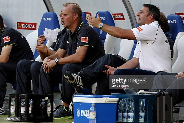 Head coach Thomas Schaaf and manager Klaus Allofs react during the Bundesliga match between 1899 Hoffenheim and Werder Bremen at the RheinNeckar...