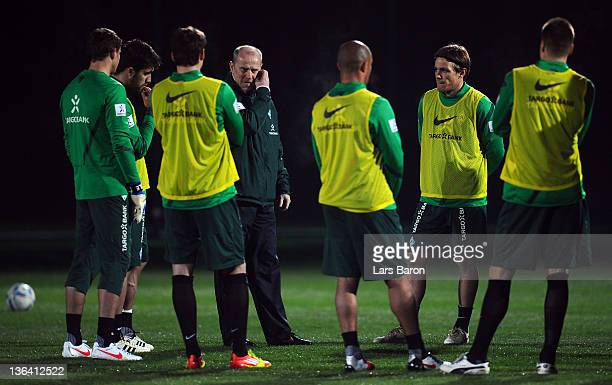 Head coach Thomas Schaaf gives instructions to his players during a training session at day one of Werder Bremen training camp on January 4 2012 in...