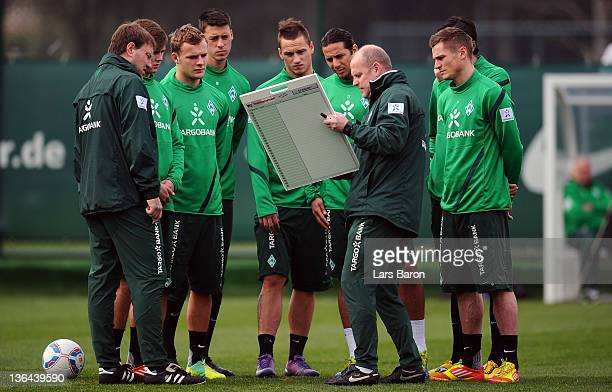 Head coach Thomas Schaaf gives instructions to his players during a training session at day two of Werder Bremen training camp on January 5 2012 in...