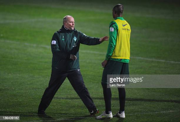 Head coach Thomas Schaaf gives instructions to Naldo during a training session at day one of Werder Bremen training camp on January 4 2012 in Belek...