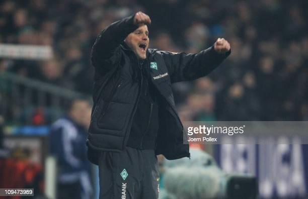 Head coach Thomas Schaaf of Bremen celebrates after Peer Mertesacker scored his team's first goal during the Bundesliga match between Werder Bremen...