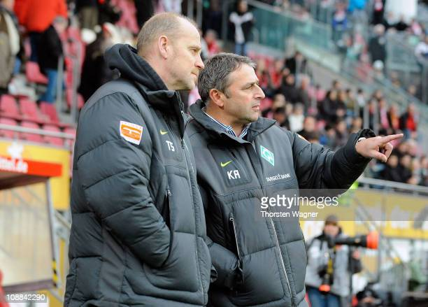 Head coach Thomas Schaaf of Bremen talks with manager Klaus Allofs prior to the Bundesligamatch between FSV Mainz 05 and SV Werder Bremen at Bruchweg...