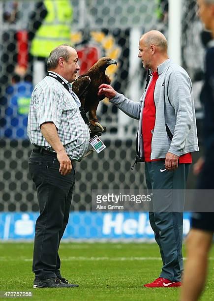 Head coach Thomas Schaaf of Frankfurt and mascot 'Attila' after the Bundesliga match between Eintracht Frankfurt and 1899 Hoffenheim at...