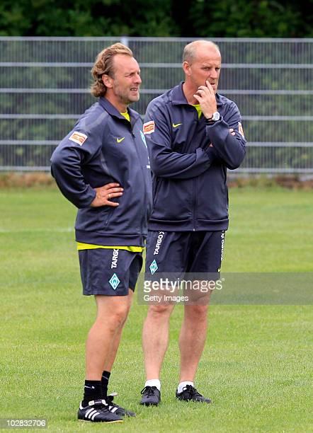 Head coach Thomas Schaaf of Werder Bremen and assistant coach Matthias Hoenerbach talk during the Werder Bremen training session on training ground...