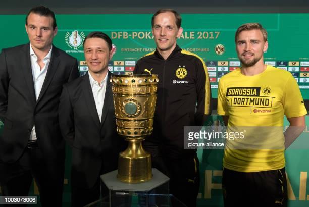 Head coach Thomas Tuchel and player Marcel Schmelzer of German Bundesliga soccer club Borussia Dortmund seen next to head coach head coach Niko Kovac...