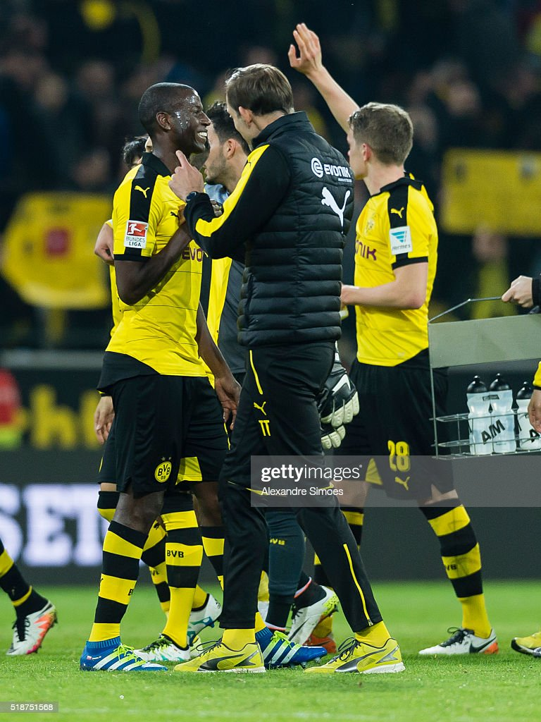 Head coach Thomas Tuchel of Borussia Dortmund celebrates the win together with Adrian Ramos after the final whistle during the Bundesliga match between Borussia Dortmund and Werder Bremen at Signal Iduna Park on April 02, 2016 in Dortmund, Germany.