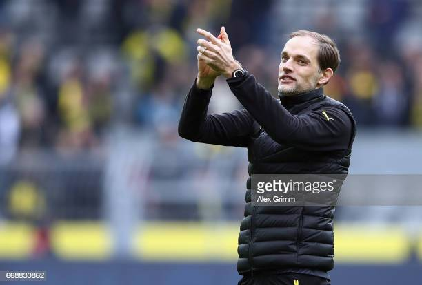 Head coach Thomas Tuchel of Dortmund applauds to the fans after the Bundesliga match between Borussia Dortmund and Eintracht Frankfurt at Signal...