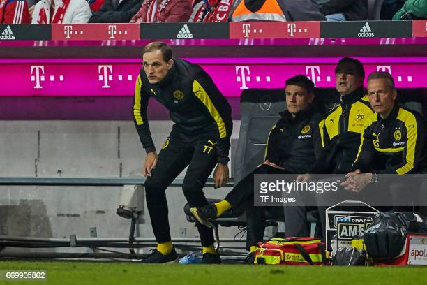 Head coach Thomas Tuchel of Dortmund Arno Michels Michael Zorc of Dortmund Rainer Schrey and Wolfgang de Beer of Dortmund looks on during the...