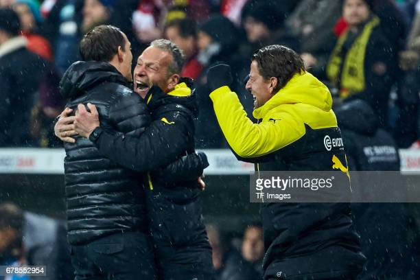 Head coach Thomas Tuchel of Dortmund Goalkeeper Roman Weidenfeller of Dortmund and Rainer Schrey of Dortmund celebrates the win after the final...