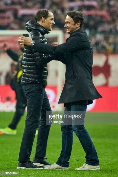 Head coach Thomas Tuchel of Dortmund shakes hands with Sascha Fligge Director of Communication during the German Cup semi final soccer match between...