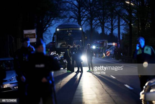 Head coach Thomas Tuchel of Dortmund stands near the team bus of the Borussia Dortmund football club after the bus was damaged in an explosion on...