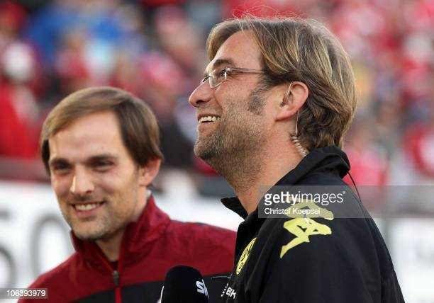 Head coach Thomas Tuchel of Mainz and head coach Juergen Klopp of Dortmund look on before the Bundesliga match between FSV Mainz 05 and Borussia...