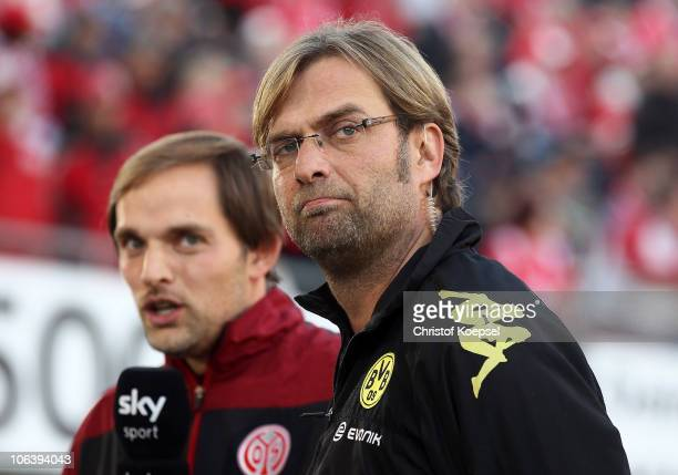 Head coach Thomas Tuchel of Mainz and head coach Juergen Klopp of Dortmund look on before the Bundesliga match between FSV Mainz 05 and Borussia...