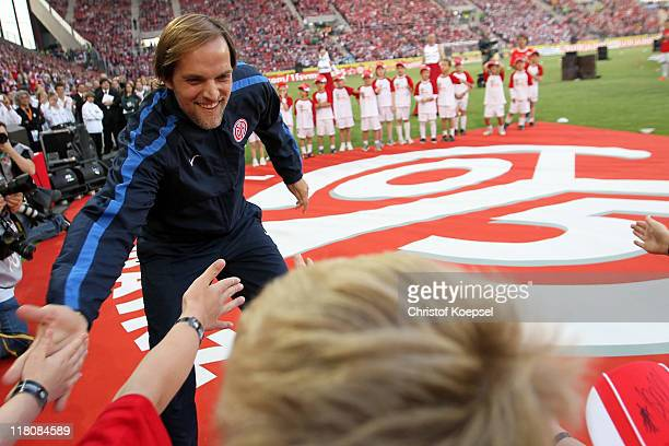Head coach Thomas Tuchel of Mainz welcomes the fans and kids during the stadium opening at Coface Arena on July 3 2011 in Mainz Germany