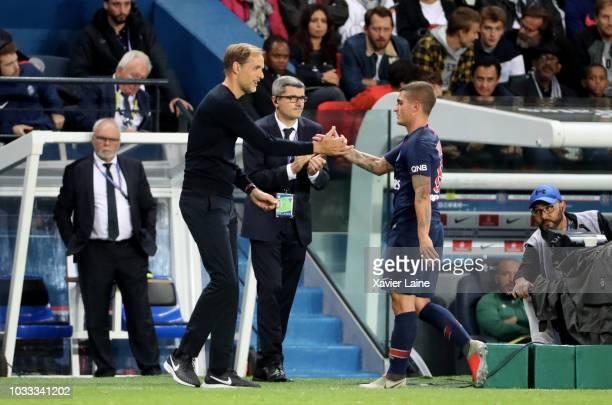Head coach Thomas Tuchel of Paris SaintGermain react with Marco Verratti during the French Ligue 1 match between Paris Saint Germain and AS Saint...