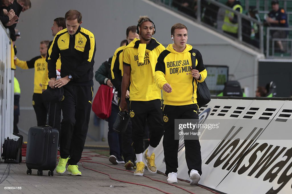 Head coach Thomas Tuchel (L) , Patrick Emerick Aubameyang (C) and Mario Goetze (R) of Dortmund arrival to the Bundesliga match between VfL Wolfsburg and Borussia Dortmund at Volkswagen Arena on September 20, 2016 in Wolfsburg, Germany.