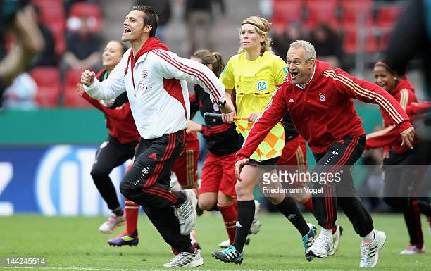 Head coach Thomas Woerle of Bayern celebrates aftern winning the DFB Women's Cup final match between 1 FFC Frankfurt and Bayern Muenchen at...
