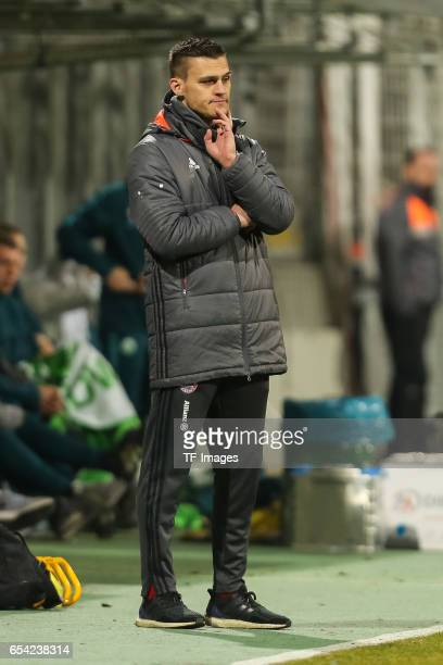 Head coach Thomas Woerle of Bayern Muenchen looks on during the Women's DFB Cup Quarter Final match between FC Bayern Muenchen and VfL Wolfsburg at...