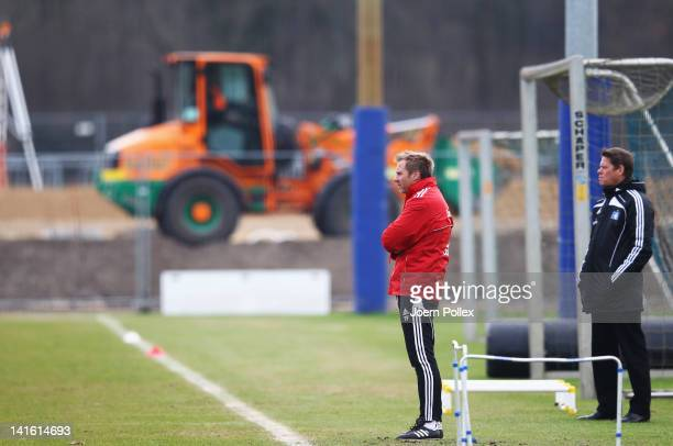 Head coach Thorsten Fink and Frank Arnesen, manager of Hamburger SV look on during a Hamburger SV training session on March 20, 2012 in Hamburg,...