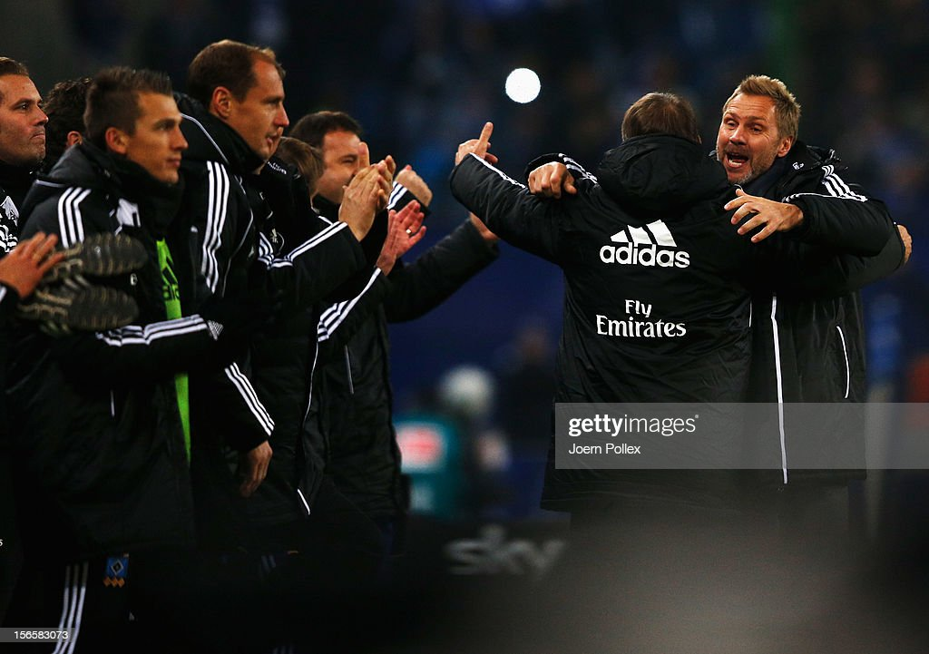 Head coach Thorsten Fink (R) and sportdirector Frank Arnesen of Hamburg celebrate after the Bundesliga match between Hamburger SV and 1. FSV Mainz 05 at Imtech Arena on November 17, 2012 in Hamburg, Germany.