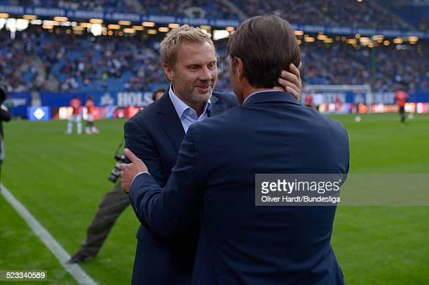 Head coach Thorsten Fink of Hamburg and Head coach Bruno Labbadia of Stuttgart shake hands before during Bundesliga match between Hamburger SV v VfB...
