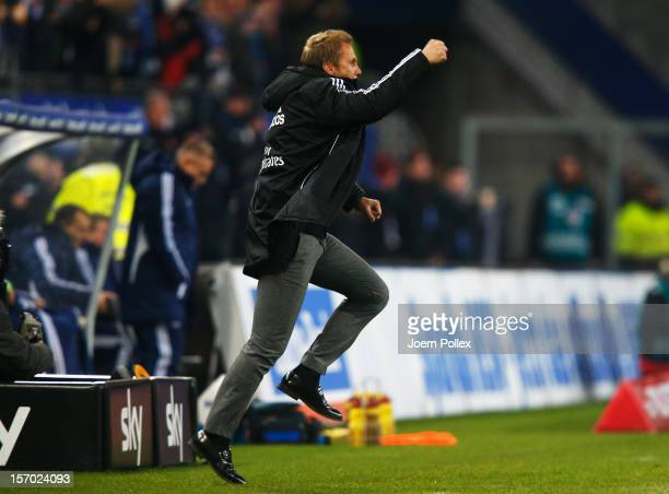 Head coach Thorsten Fink of Hamburg celebrates after the Bundesliga match of Hamburger SV and FC Schalke 04 at Imtech Arena on November 27, 2012 in...