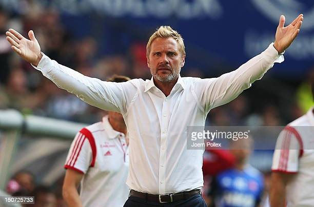 Head coach Thorsten Fink of Hamburg gestures during the Bundesliga match between Hamburger SV and 1 FC Nuernberg at Imtech Arena on August 25 2012 in...