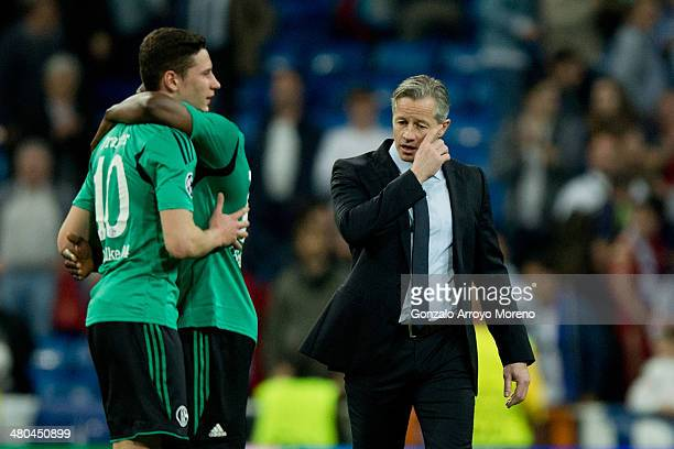 Head coach Tim Bodenroder of FC Schalke 04 leaves the pitch close to his players Julian Draxler embraced with Chinedu Obasi after the UEFA Champions...