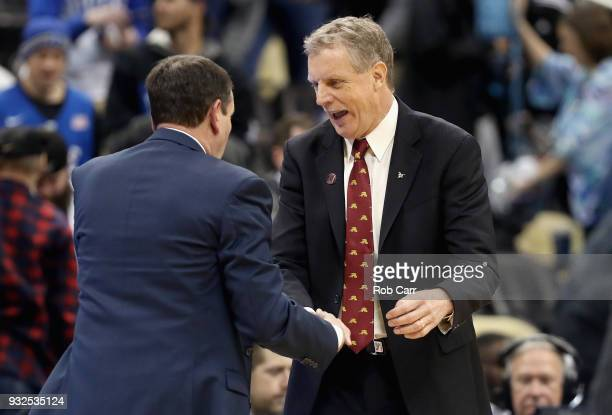 Head coach Tim Cluess of the Iona Gaels congratulates head coach Mike Krzyzewski of the Duke Blue Devils after Duke defeated the Iona Gaels 8967 in...