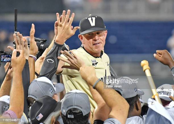 Head coach Tim Corbin of the Vanderbilt Commodores celebrates after defeating the Michigan Wolverines to win the National Championship at the College...