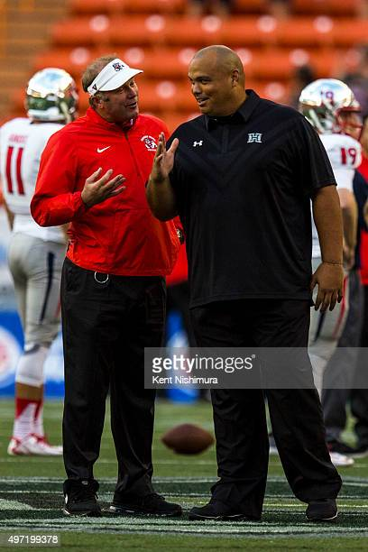 Head coach Tim Deruyter and interim head coach Chris Naeole of the Hawaii Warriors of the Fresno State Bulldogs during a college football game at...