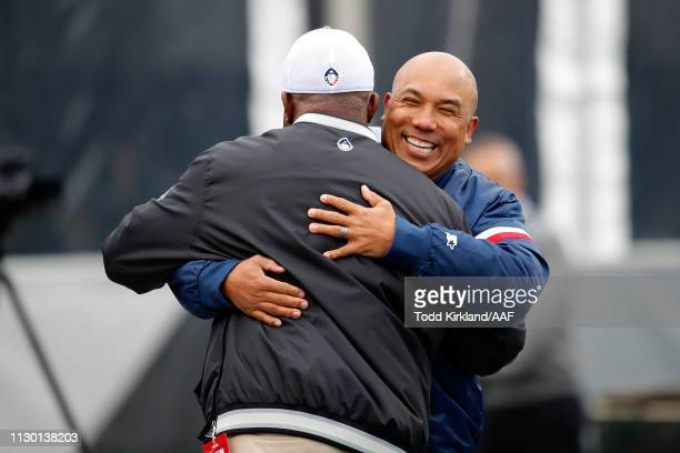 Head coach Tim Lewis of Birmingham Iron hugs former NFL player Hines Ward prior to an Alliance of American Football game between the Birmingham Iron...