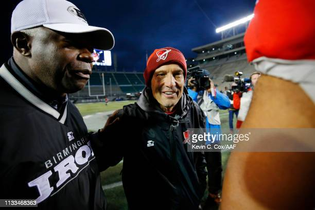 Head coach Tim Lewis of the Birmingham Iron talks with head coach Mike Riley of the San Antonio Commanders after the San Antonio Commanders defeated...