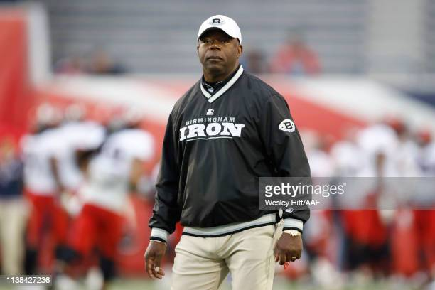Head Coach Tim Lewis of the Birmingham Iron watches his team warm up before a game against the Birmingham Iron at the Liberty Bowl Memorial Stadium...