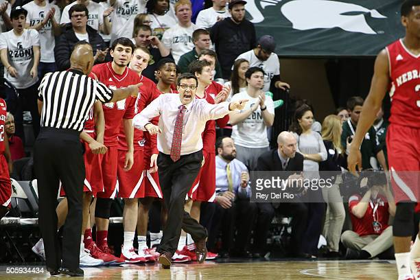 Head coach Tim Miles of the Nebraska Cornhuskers has a word with the referee in the second half of the game against the Michigan State Spartans at...