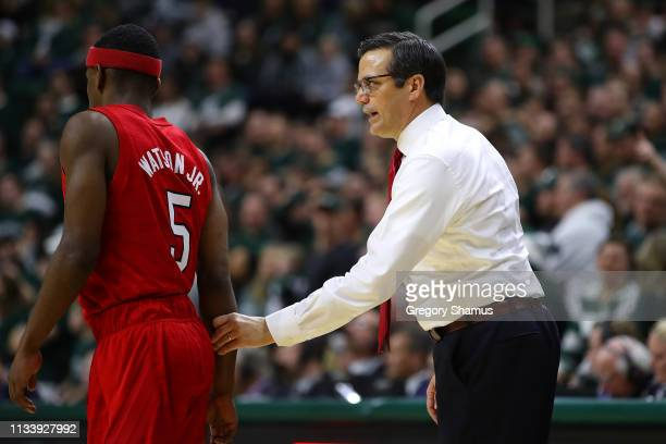 Head coach Tim Miles of the Nebraska Cornhuskers talks to Glynn Watson Jr #5 while playing the Michigan State Spartans at Breslin Center on March 05...