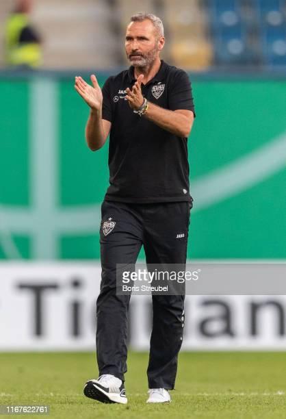 Head coach Tim Walter of VfB Stuttgart applauds after winning the DFB Cup first round match between Hansa Rostock and VfB Stuttgart at Ostseestadion...