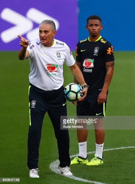 Head coach Tite and Gabriel Jesus take part in a training session at the Beira Rio Stadium on August 29 2017 in Porto Alegre Brazil ahead of their...