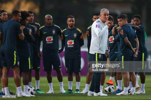 Head coach Tite asks the fans to be quiet during a training session of the Brazilian national football team at the squad's Granja Comary training...