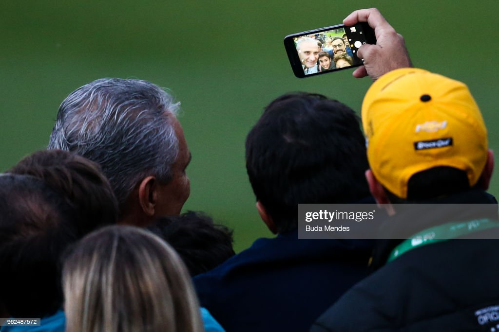 Head coach Tite makes a selfies with a fans after a training session of the Brazilian national football team at the squad's Granja Comary training complex on May 25, 2018 in Teresopolis, Brazil.