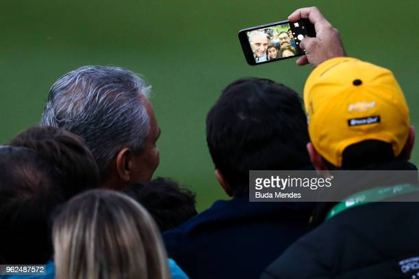 Head coach Tite makes a selfies with a fans after a training session of the Brazilian national football team at the squad's Granja Comary training...