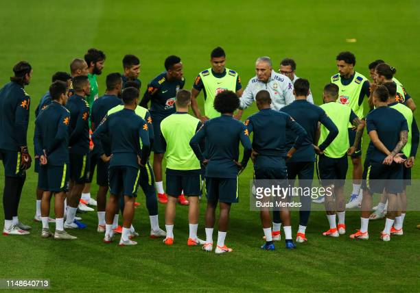 Head coach Tite talk with his players in a training session at Beira Rio stadium on June 08, 2019 in Porto Alegre, Brazil.