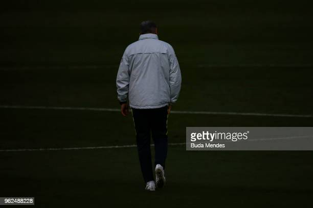Head coach Tite walks after a training session of the Brazilian national football team at the squad's Granja Comary training complex on May 25 2018...