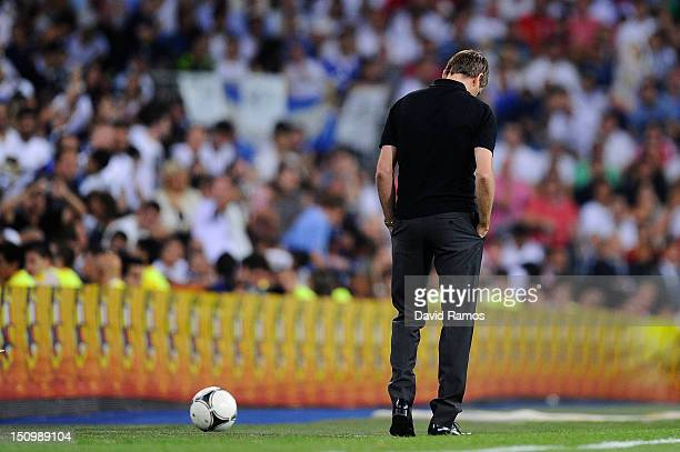 Head coach Tito Vilanova of FC Barcelona looks down dejected Barcelona during the Supercopa second leg match betwen Real Madrid and FC Barcelona at...
