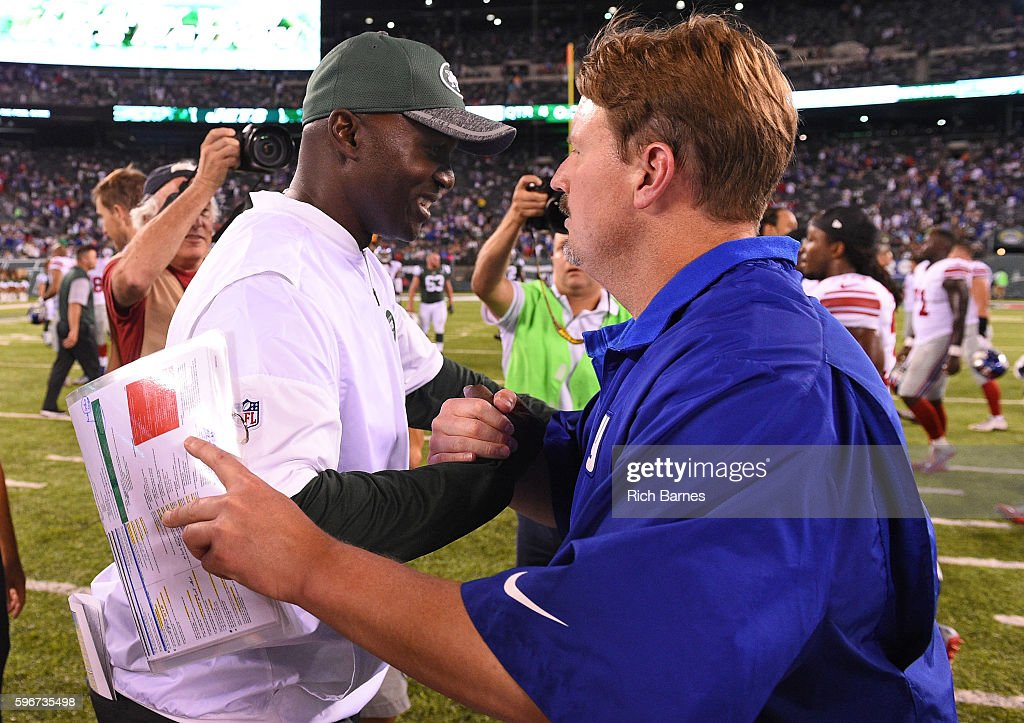 Head coach Todd Bowles of the New York Jets and head coach Ben McAdoo of the New York Giants shake hands following a preseason game at MetLife Stadium on August 27, 2016 in East Rutherford, New Jersey. The Giants defeated the Jets 21-20.