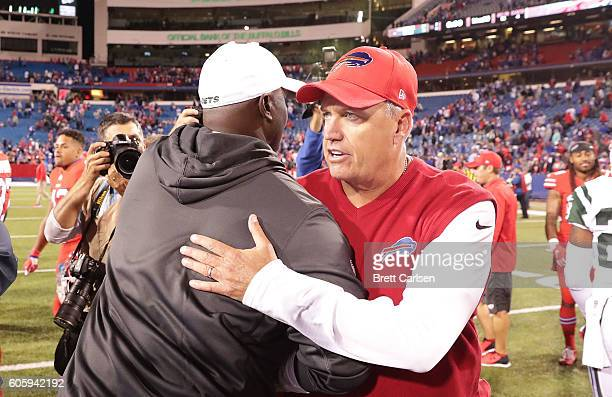 Head Coach Todd Bowles of the New York Jets and Head Coach Rex Ryan of the Buffalo Bills speak after the game where the New York Jets beat Buffalo...