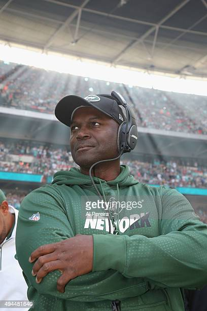 Head Coach Todd Bowles of the New York Jets follows the action as sunbeams streak down against the Miami Dolphins at Wembley Stadium on October 4...