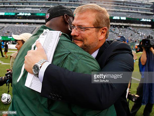 Head coach Todd Bowles of the New York Jets is hugged by General Manager Mike Maccagnan after defeating the Cleveland Browns 3110 for his first win...