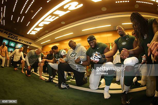 Head Coach Todd Bowles of the New York Jets leads the postgame prayer in the locker room after the game against the Buffalo Bills at MetLife Stadium...