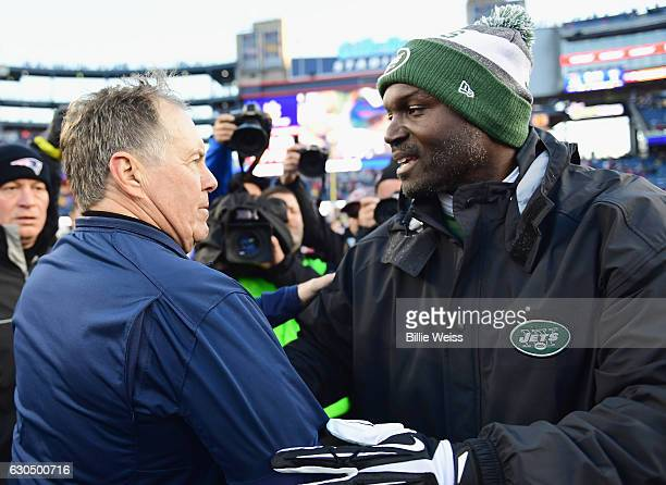Head coach Todd Bowles of the New York Jets shakes hands with head coach Bill Belichick of the New England Patriots after a game at Gillette Stadium...